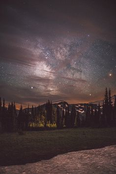 Milky Way through the clouds in Mt Rainier National Park.