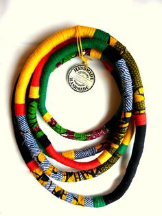 Unique, yarn wrapped necklace/ African Wax Print fabric wrapped/ Eye catcher/ African style - pinned by pin4etsy.com