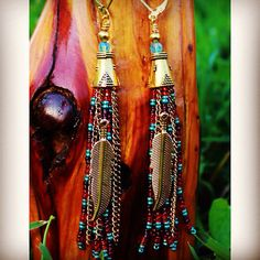 Multicolored seed bead and gold chain earrings with gold feather, boho earrings, fringe earrings, feather earrings, dangle earrings on Etsy, $35.00
