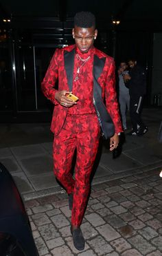 Paul Pogba looked particularly dashing in his red and black suit Paul Pogba Manchester United, Manchester United Players, Pogba Wallpapers, Manchester City Wallpaper, Adidas Backgrounds, Cardi B Photos, Chelsea Fans, Messi And Ronaldo, Trending Today