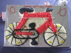 Homemade Bicycle Cake: I made this Bicycle Cake for our son's 10th birthday, yes he got a new bike. I made two 15cm cakes for the wheels (didn't have the right size tin so used