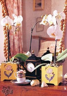 Orchids in pretty toile containers.