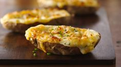 Twice-baked potatoes are one of our favorite dinner sides. Made with butter, stuffed with cheese and topped with sour cream or fresh chives, twice-baked potatoes go with any meal.