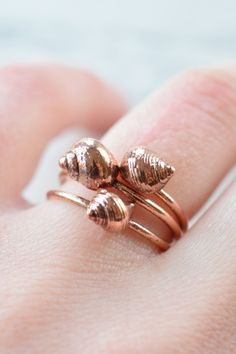 Underneath the copper coating on this ring, lies a real shell found on the beach in Northern England.