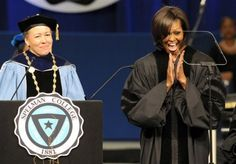 Mrs. Obama, right, reacts while receiving an honorary degree from Spelman College president Beverly D. Tatum.