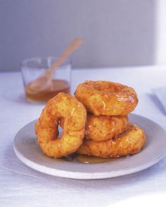 """These anise seed-infused pumpkin and sweet potato doughnuts are deliciously addictive and very easy to make. Picarones are a popular snack all over Ecuador and Peru, and are traditionally accompanied by """"chancaca,"""" a sugarcane syrup. They work very well served piping hot with honey or sugar syrup, or even maple syrup if you prefer. The sweetness of the sweet potato and pumpkin combines beautifully with the spices, black pepper, and salt, topped off with a drizzle of golden honey."""