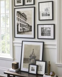 frames on the wall, frames on the table.