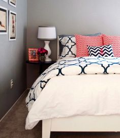 navy and white patterned bedsheets with pink accents