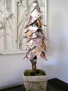 Quilted Fabric Christmas Tree -sew & quilt each 'leaf'.   Attached leaves to a foam cone.  Shoved a branch or stick in the bottom of cone to serve as trunk.   Jute twine was used to cover the top of the cone. Root truck in floral foam and cover with reindeer moss.