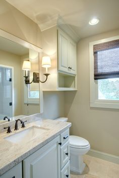 Guest Bathroom.  Great idea re: over the toilet cabinet...love the molding!