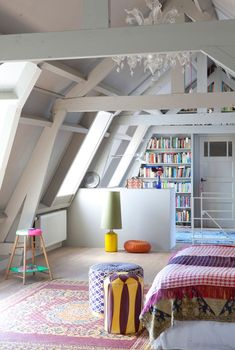 This converted attic space is stunning - colourful, bright and spacious.