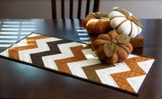 We have great fall fabrics in the works. You only need fat quarters for a fall theme table runner and trio of stuffed pumpkins.