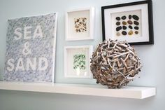 Lazy Summer Day DIY: beach art. Use found pebbles, sea glass, or shells to create one-of-a-kind wall art, practically for free. To make, simply arrange objects on card stock and attach them with glue, then place your masterpiece in a shadow box or frame it with a regular picture frame with the glass removed.