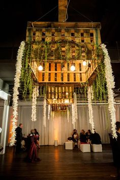 Innovative and eclectic, these upside down crates teaming with greenery, white…