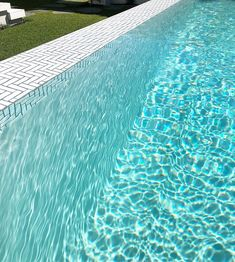 Im obsessed with it. A lovely close up of this white plaster above ground pool with feature tiled infinity edge.