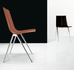 Mayfair Dining Chair for Sale at Deko Exotic Home Accents. Features carbon steel frame with leather seat. Measures 19 x 22 x 33. Available in multiple colors.
