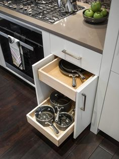 Pull-out drawers to the right of the stove house the most-used cookware, making it easy to store and find each piece when needed.