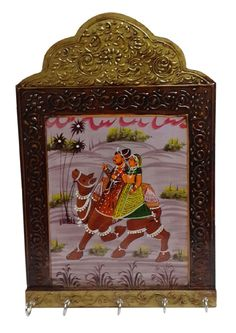 Dineshalini Creations presents a unique, artistic, ethnic and colourful wooden key holder, an authentic  piece of Rajasthan art. Utility with variations is the quality of Rajasthani art culture. Wooden work is minutely crafted and designed by craftsmen.    Dineshalini Key Holder - Wooden - Brown - 1pc, is a unique wooden masterpiece and are specially made for the décor of your home as well as your easy utilisation. It can be utilised  as a key holder as well as a decorative piece of royal a