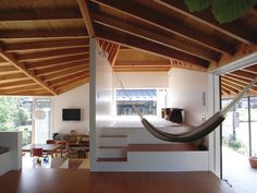 playful, beautiful, open space. loooove that hammock.