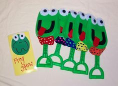 Five green and speckled frogs (using green shovels as props!!)