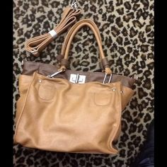 Two Tone Handbag Multiple pockets and an additional long strap makes this a very versatile handbag for any season! Zippered inside compartment and multiple pockets. Medium tone saddle and light brown. Bags