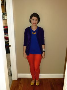 No black. Royal blue shirt, purple cardigan, orange pants, yellow shoes and necklace.