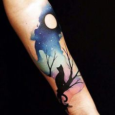 Night sky and cat tattoo on arm.                                                                                                                                                      More