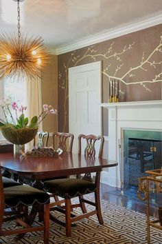 Style Profile: Laura Tutun--look at these details--glassed ceiling, modern candelier and rug and fabulous cherry blossom wallpaper.