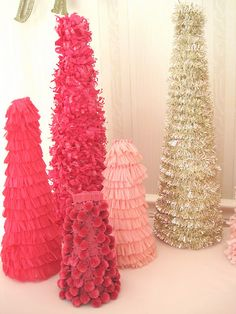 DIY Christmas Trees - Use the standard size silver garland, and it the tree will be so full.