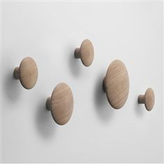 Simple and functional oak Dots which provide both a place to hang your coats and a decorative architectural feature. Saw these on Dicte, Danish crime journalist series on Netix.