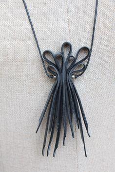 Innertube necklace by CutAndPasteWorkshop on Etsy https://www.etsy.com/listing/179305855/innertube-necklace