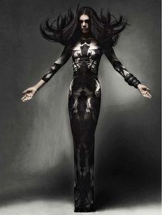 Statuesque dark beauty: black hair, patterned dress. By Mathew Guido