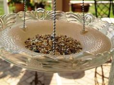 Repurpose a vintage glass ceiling light cover as a bird feeder