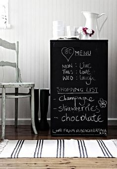 Chalkboard refrigerator paint. Wonder if you still need to use the magnetic kind.