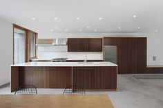New construction kitchen design by SHED Architecture & Design.  Ikea box units with custom bamboo fronts.