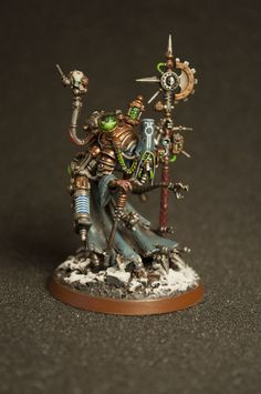 Forge World Belacane Tech-Priest Dominus. I like how the color scheme resembles copper with a patina. That's what it reminds me of, anyway.