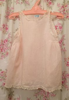 A personal favorite from my Etsy shop https://www.etsy.com/listing/275594048/vintage-baby-slip-fancy-pink-slip