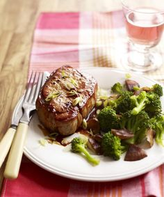 """Add a kick to juicy pork chops with a """"shot"""" of garlic- and ginger-infused whiskey glaze."""