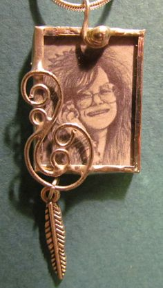 Stained glass pendant…silver soldered glass with silver scroll accents. Print of my original artwork of Janis Joplin. Silver chain. $30