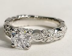 If i ever get married again, i really love this type of ring!  too bad it costs $10,000!!!