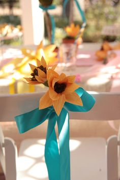 Crepe paper sunflower chair back.  We used the flowers to decorate chair backs for our little guests.