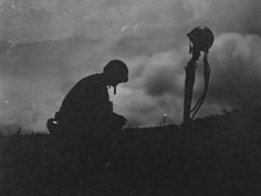 A Marine mourns the loss of a friend during the Battle of Okinawa, 1945