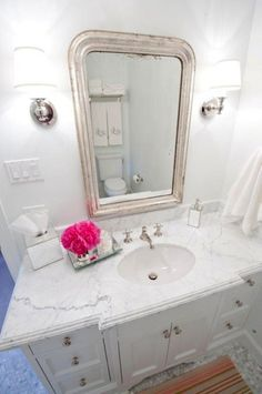 Suzie: Munger Interiors - Chic white bathroom with single white bathroom vanity cabinet with ...