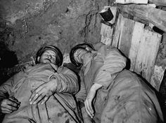 American soldiers sleep in a dugout during a lull in the fighting, Anzio, Italy, 1944.