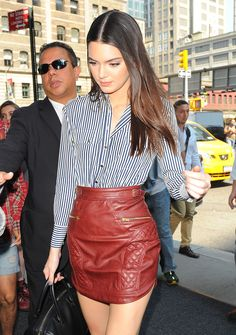 via By Sasha - Kendall Jenner street style leather skirt and stripped shirt