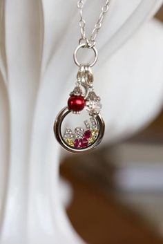 Awesome graduation gift for your Senior!  Or show you school spirit with this great Origami Owl locket!  O2 has letters and numbers so you can even create your own locket supporting your favorite player! http://lindsayd.origamiowl.com