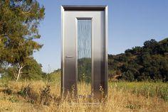 Neoporte Modern Door's modern steel door and modern steel pivot door entry systems in stainless steel, ERA (Cor-ten), & painted steel finishes. Made in USA.