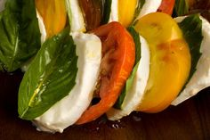 Basic Caprese Salad - use the best quality olive oil and mozzarella you can find | CSA crops: tomatoes, basil