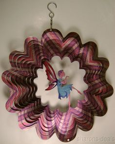 """Iron Stop Fairy Primary colors: Red, Blue, & Purple (colors change in light as it spins) Wind Spinner 10"""" Diameter x 1-1/2"""" Deep #IronStop"""