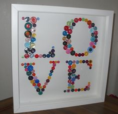 "Stunning 'LOVE' button artwork made with a selection of multi-coloured buttons of all shapes and sizes, individually glued in place and displayed in a beautiful deep box frame. Could do this for ""WILL"" to put in his room!"